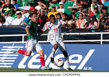 PASADENA, CA - JULY 7: Alberto Quintero #19 of Panama and Israel Jimenez #2 of Mexico during the 2013 CONCACAF Gold Cup game between Mexico and Panama on July 7, 2013 at the Rose Bowl in Pasadena, Ca.