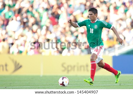 PASADENA, CA - JULY 7: Juan Carlos Valenzuela #18 of Mexico during the 2013 CONCACAF Gold Cup game between Mexico and Panama on July 7, 2013 at the Rose Bowl in Pasadena, Ca.