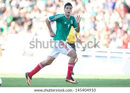 PASADENA, CA - JULY 7: Raul Jimenez #9 of Mexico during the 2013 CONCACAF Gold Cup game between Mexico and Panama on July 7, 2013 at the Rose Bowl in Pasadena, Ca.