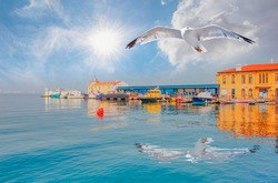 Pasaport pier the most popular destination in izmir with seagull flying over the calm sea - İzmir, Turkey