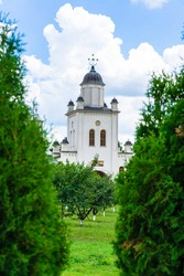 Pasarea monastery, orthodox church architectural details. View of Orthodox church and green churchyard.