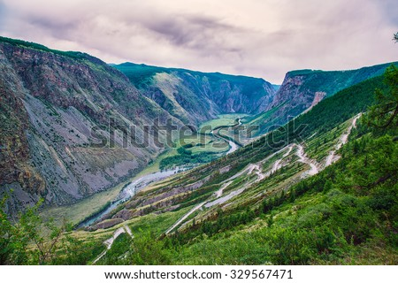 pass in a mountain valley with a river #329567471