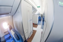 Passage on a passenger plane next to the toilet in economy class