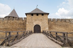 Passage to the medieval castle, main gate, the wooden bridge, the only door. Ancient fort.