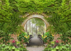 Passage to the summer sunny park through the arch with flowers