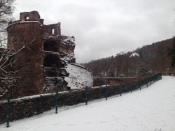 passage way with castle ruined covered by snow and Beautiful winter field and trees landscape. Snow covered germany heidelberg landscape.