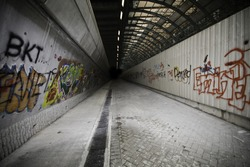 Passage with graffiti covered walls