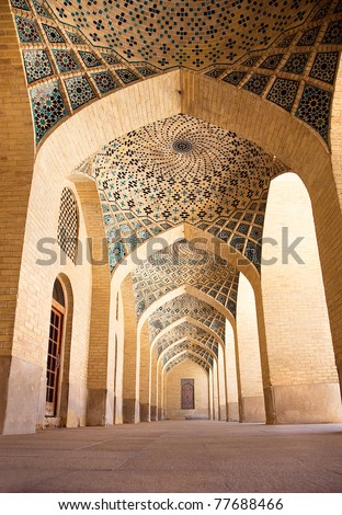 Passage with pillars of Prayer Hall, , Nasir al-Molk Mosque, Shiraz, Iran - stock photo