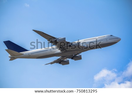 Passanger airplane taking off in the blue sky