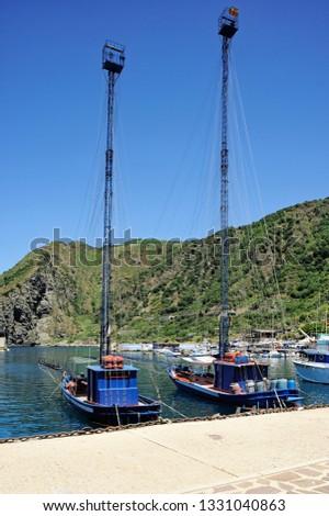 Passarella or Feluca typical boat for fishing for swordfish in the port of Bagnara Calabra, District of Reggio Calabria, Calabria, Italy #1331040863