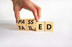 Passed or failed symbol. Businessman turns wooden cubes and changes the word 'failed' to 'passed' on a beautiful white table, white background. Business and passed or failed concept. Copy space.