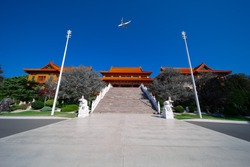 Passenger aero plane flying over a Buddhist temple in Wollongong NSW Australia