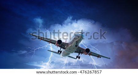 Passenger aeroplane throught turbulent thunderstorm and lightnings