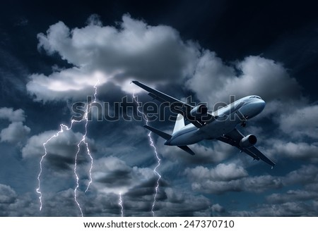 Passenger aeroplane yielding turbulent thunderstorm and lightnings