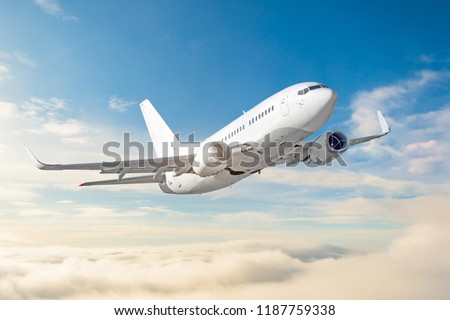 Passenger aircraft cloudscape with white airplane is flying in the daytime sky overcast