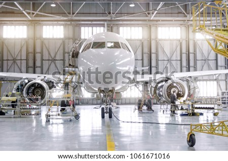 Passenger aircraft on maintenance of engine-disassembled engine blades and fuselage repair in airport hangar