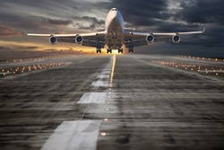 Passenger aircraft takes off from the airport runway. The plane is climbing into the sunset sky.