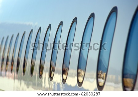 passenger airline windows from outside - stock photo
