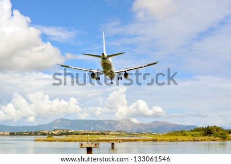 Passenger airplane few moments before landing to active runway