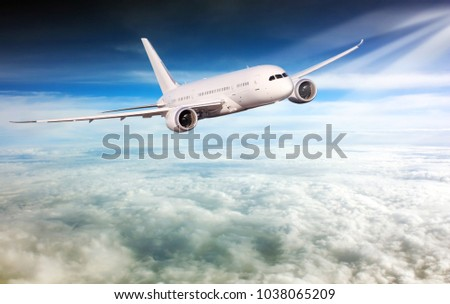 Passenger airplane flying above clouds