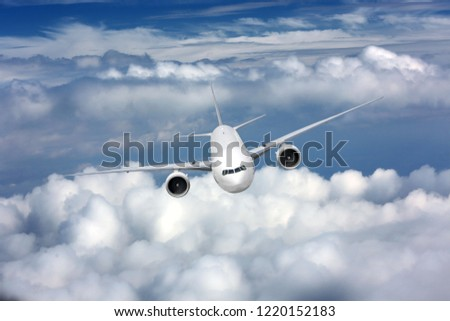 Passenger airplane flying on a high altitude over the clouds