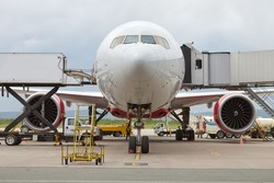 Passenger airplane prepares for departure. Engineers check aircraft systems. Service and maintenance of airplanes. Aviation and transportation
