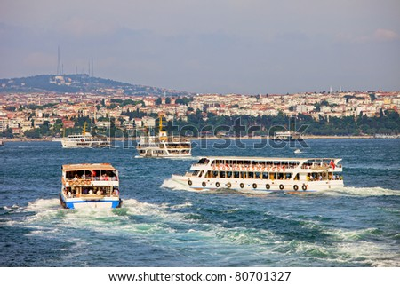 Passenger boats on the Bosphorus Strait with view on the Asian Side of Istanbul, Turkey