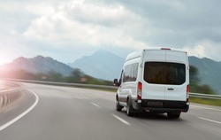 passenger bus van accelerating on a background of mountains