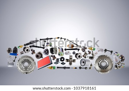 Passenger car assembled from new spare auto parts for shop aftermarket. Isolated on grey background.