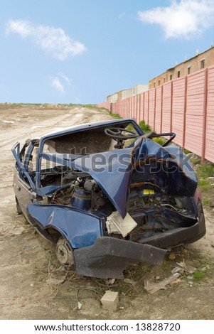 passenger car heavily crashed in road incident drop neglected place