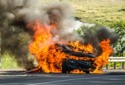 passenger car in a fire big fire, lots of smoke