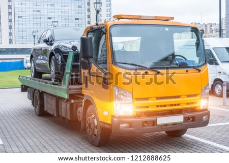 Passenger car loaded onto a recovery truck for transportation
