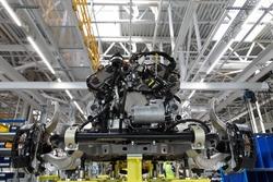 Passenger car manufacturing central assembly line. Automobile plant.