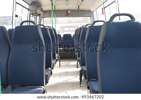 passenger compartment of a big shuttle bus - Shutterstock ID 493467202