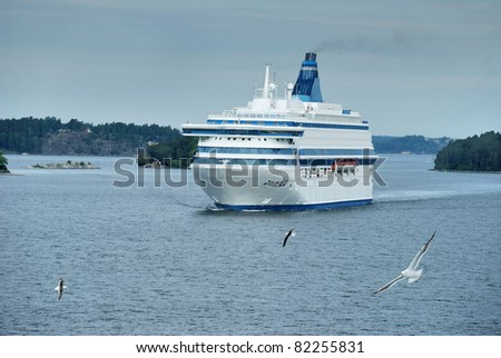 Passenger cruise ferry boat moves to port in Baltic.
