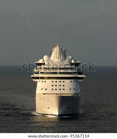 Passenger cruise ship at sea front view