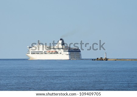 passenger ferry ship leaving port of Riga