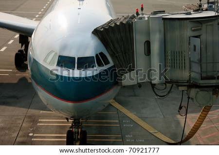 Passenger gate way of plane in Air port, Hong Kong. - stock photo