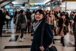 Passenger girl in Osaka train station. Major railway station in the Umeda district.