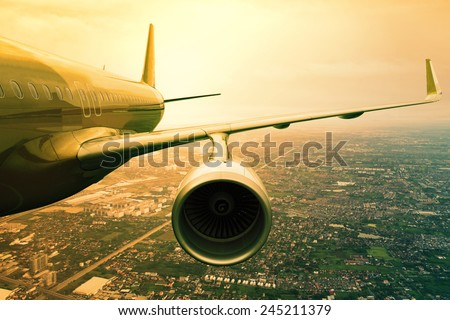 passenger jet plane flying  above urban scene  use for aircraft transportation and traveling business background
