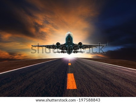 passenger jet plane flying over airport runway against beautiful dusky sky use for aircraft transport and cargo logistic and traveling business industry