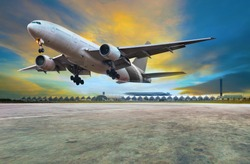 passenger jet plane landing on air port runways against beautiful dusky sky use for travel business and air transport ,cargo logistic service industry
