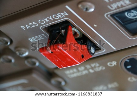 Passenger Oxygen Masks Manual Release Switch on the Overhead Panel in the Cockpit of a Jumbo Jet #1168831837