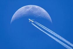 Passenger plane - airliner passes near the moon. Explore new frontier. Space traveler concept