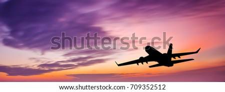 passenger plane at sunset