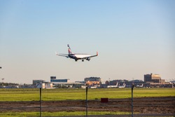 Passenger plane flying goes on takeoff in the blue sky