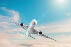 Passenger plane flying in the daytime sky overcast, cloudscape