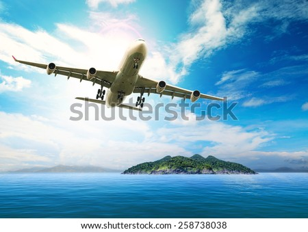 passenger plane flying over beautiful blue ocean and island in purity destination sea beach use for summer holiday vacation traveling