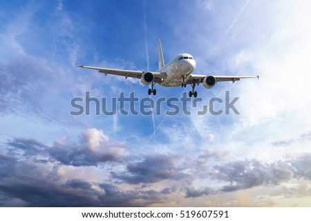 Passenger plane take off from runways against beautiful cloudy sky. #519607591