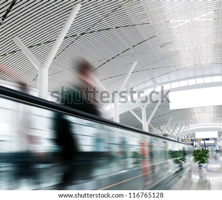 passenger rushing through an escalator in airport terminal